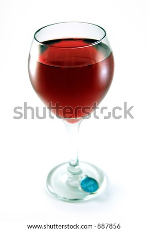 Glass of red table wine isolated on white