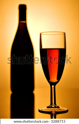 glass of red wine and a bottle - stock photo