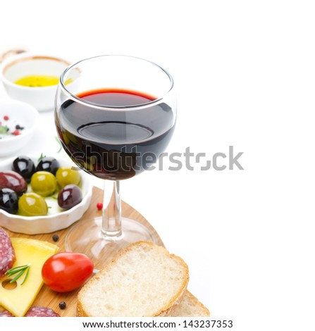 glass of red wine and appetizers - cheese, bread, salami, olives isolated on white