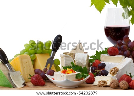 Glass of red wine and assorted cheeses with Fruit