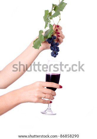 Glass of red wine and grape hand thwarted
