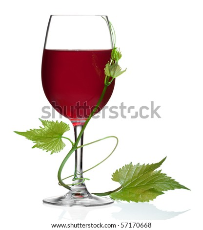 Glass of red wine and grape leaves on a white background and with soft shadow.