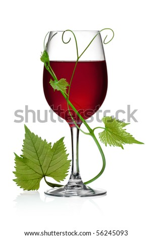 Glass of red wine and grape leaves on a white background and with soft shadow. The file includes a clipping path.