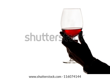 glass of red wine in hand, isolated