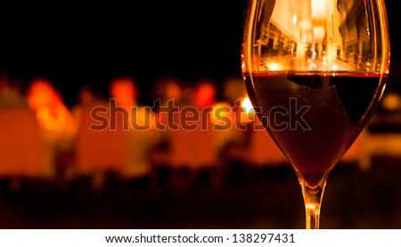 Glass of Red Wine in Romantic Restaurant Setting