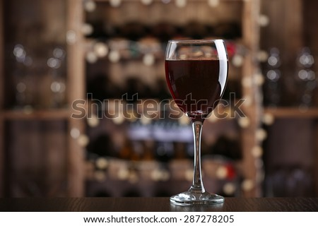 Glass of red wine on bar background #287278205