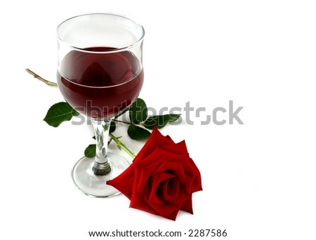 glass of red wine with a red rose