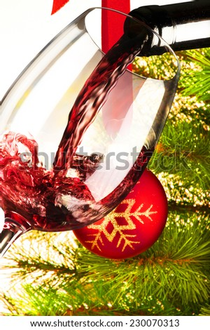 glass of red wine with Christmas tree  #230070313