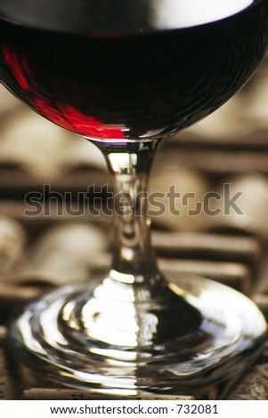 glass of red wine with corks #732081