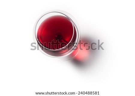 Glass of red wine with shadow.Top view