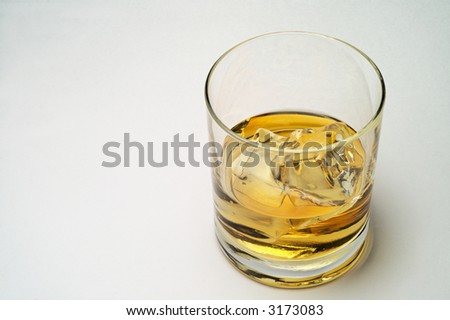 Glass of scotch and ice horizontal