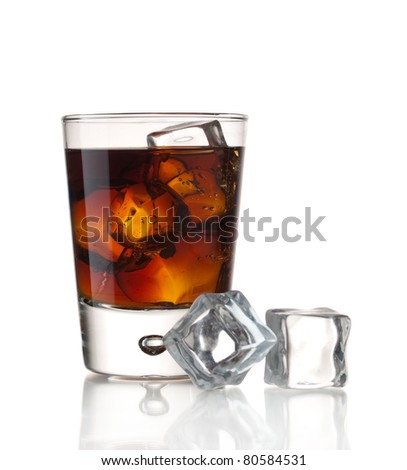 Glass of soda and ice cubes isolated on white