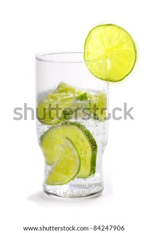 Glass of soda water with sliced limes in it