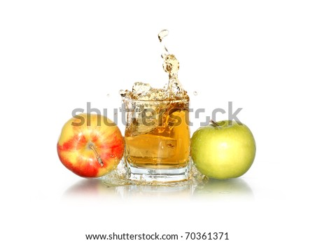 Glass of splashing apple juice near apples. Isolated on white with clipping path