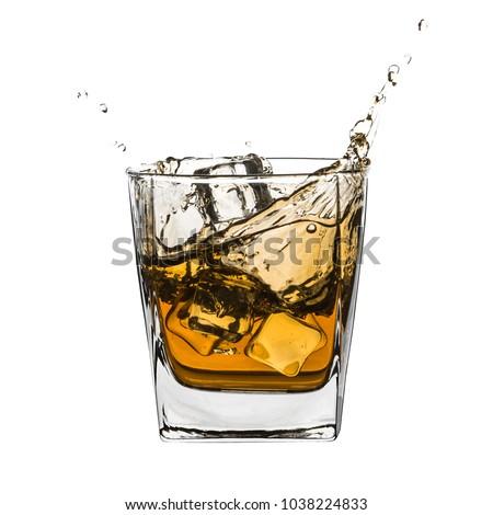 Glass of splashing whiskey with ice isolated on white #1038224833