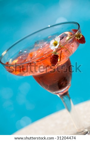 Glass of strawberry summer alcohol cocktail garnished with - Get a swimming pool full of liquor ...