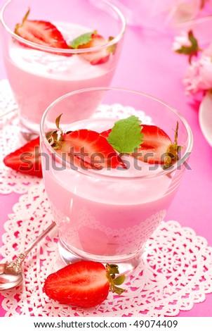 glass of strawberry yogurt with fresh fruits