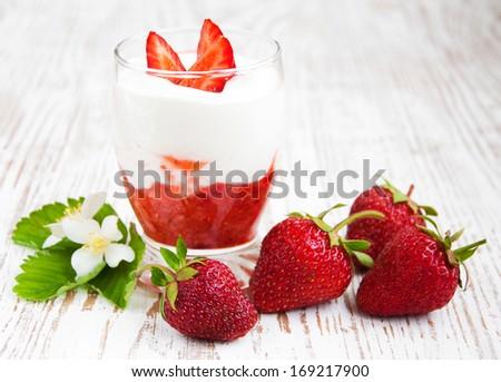 Glass of strawberry yogurt, with fresh strawberries