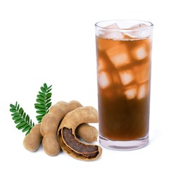 Glass of tamarind juice and fresh tamarind fruit with green leaf isolated on white background.