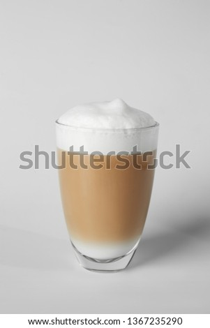 Glass of tasty frappe coffee on light background #1367235290