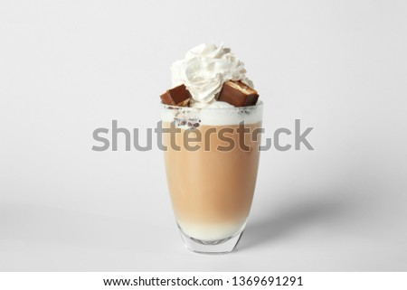 Glass of tasty frappe coffee on light background #1369691291