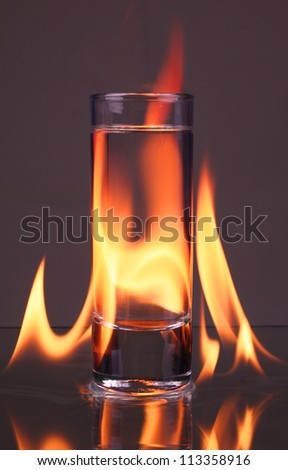 Glass of tequila and flames