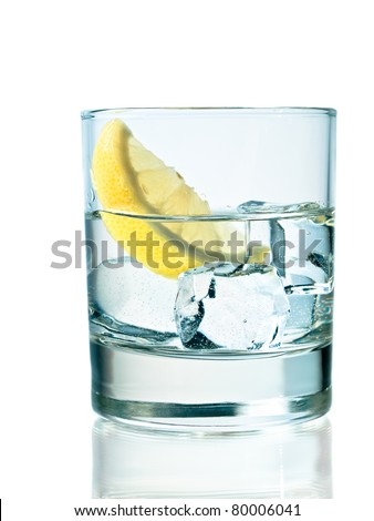 Glass of vodka on the rocks with lemon