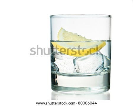 Glass of vodka on the rocks with lemon