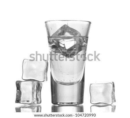glass of vodka with ice isolaled on white