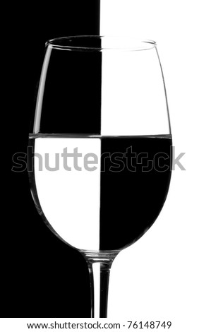 Glass of water against white and black background