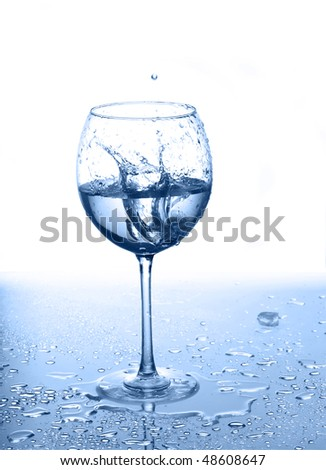 Glass of water and ice with drops on a white background