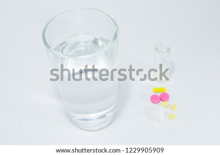 glass of water and tablets pills #1229905909