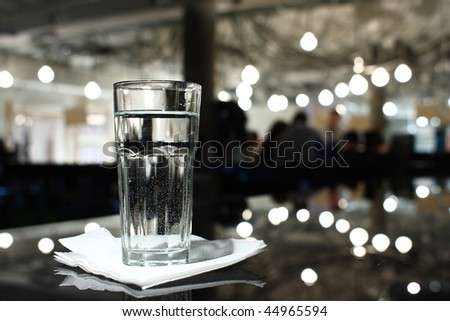glass of water on a bar