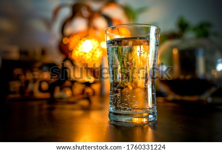 Glass of water on the bar. Water glass close up. Glass of water bar