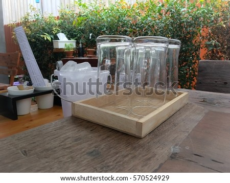 glass of water on wood table #570524929