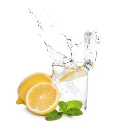 Glass of water with lemon and mint on white background