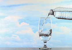 glass of wather on the table sky background