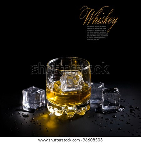 glass of whiskey and ice  over a black background