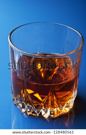 glass of whiskey on background