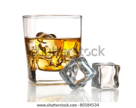 Glass of whiskey on the rocks and ice cubes, isolated on white