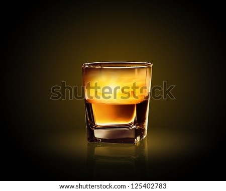 Glass of whiskey with city illustration in it
