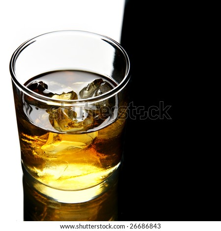 Glass of whisky with ice with space for text on right