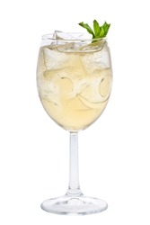 Glass of white sparkling wine with ice cubes mint