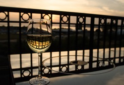 Glass of white wine at balcony near Blaine moorage, Washington