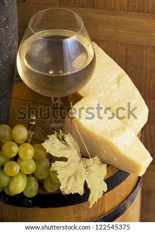 glass of wine and grapes on wooden