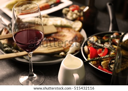 Glass of wine and grilled vegetables on served table #515432116