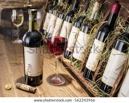Glass of wine and wine bottle. Wine testing at the storage. Wine cellar. Stock photo ©