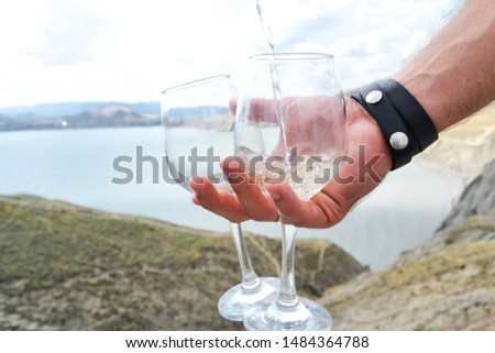 glass of wine on the background of the sea and mountains, beautiful romance holiday
