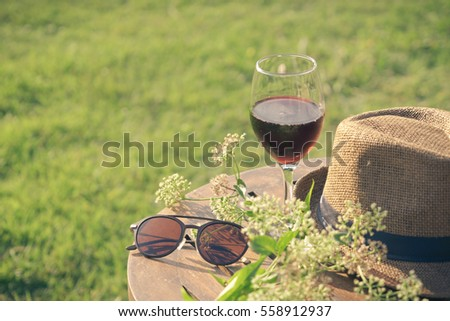 Glass of wine on the table  in park