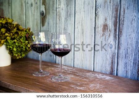 Glass of wine. Rustic vintage setup. Food and beverage concept